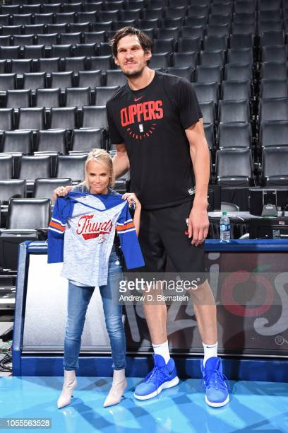 Actress Kristin Chenoweth poses for a photo with Boban Marjanovic of the LA Clippers before the game against the Oklahoma City Thunder on October 30...