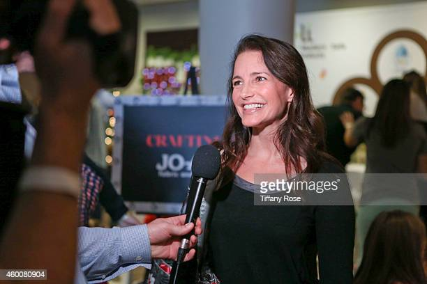 Actress Kristin Davis attends the 4th Annual Santa's Secret Workshop Benefiting LA Family Housing at Andaz Hotel on December 6 2014 in Los Angeles...