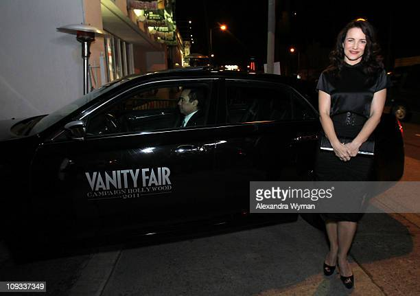 """Actress Kristin Davis poses with a Chrysler 300 as Vanity Fair Campaign Hollywood 2011 kicks off with Chrysler Celebrating """"The Fighter"""" held at the..."""