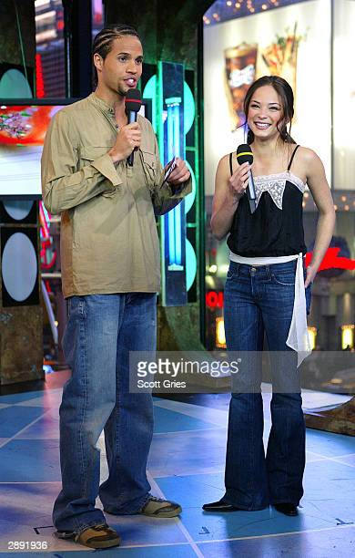 Actress Kristin Kreuk appears on stage with MTV VJ Quddus during MTV's Total Request Live at the MTV Times Square Studios January 22 2004 in New York...
