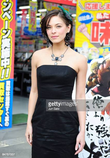 Actress Kristin Kreuk poses for photographers at Akihabara shopping street on February 12 2009 in Tokyo Japan Kreuk is in Tokyo to promote her latest...
