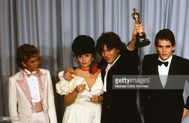 Actress Kristy McNichol and actor Matt Dillon pose backstage with Zbigniew Rybczynski winner of Best Animated Short during the 55th Academy Awards at...