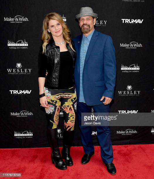 Actress Kristy Swanson and figure skater Lloyd Eisler attend Waiting for Wishes Celebrity Waiters Dinner hosted by Kevin Carter Jay DeMarcus on April...