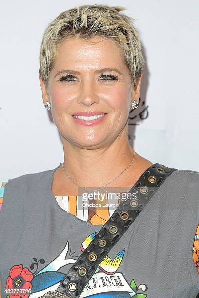 Actress Kristy Swanson arrives at the 6th annual Kiehl's LifeRide for amfAR celebration at Kiehl's Since 1851 on August 12, 2015 in Santa Monica,...