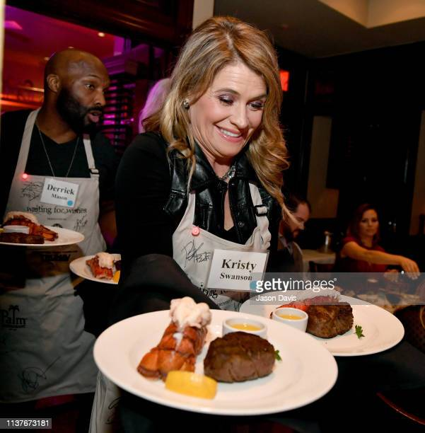 Actress Kristy Swanson serves food during Waiting for Wishes Celebrity Waiters Dinner hosted by Kevin Carter & Jay DeMarcus on April 16, 2019 in...