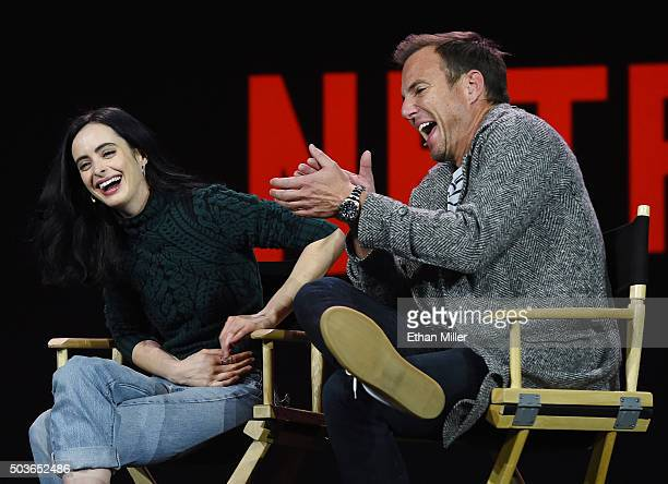 Actress Krysten Ritter and actor Will Arnett laugh during a keynote address by Netflix CEO Reed Hastings at CES 2016 at The Venetian Las Vegas on...