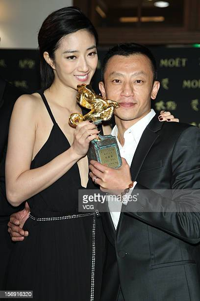Actress Kwai LunMei poses with director Yache Yang during a celebration after the 49th Golden Horse Awards on November 24 2012 in Ilan Taiwan