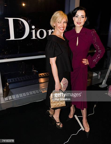 Actress Kylie Minogue and Dita Von Teese pose backstage at the Dior 2008 Cruise collection fashion show on May 14 2007 in New York City