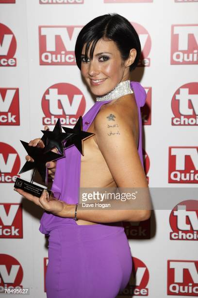 Actress Kym Ryder poses with her award for best soap newcomer at the 2007 TV Quick and TV Choice Awards at the Dorchester Hotel September 3 2007 in...