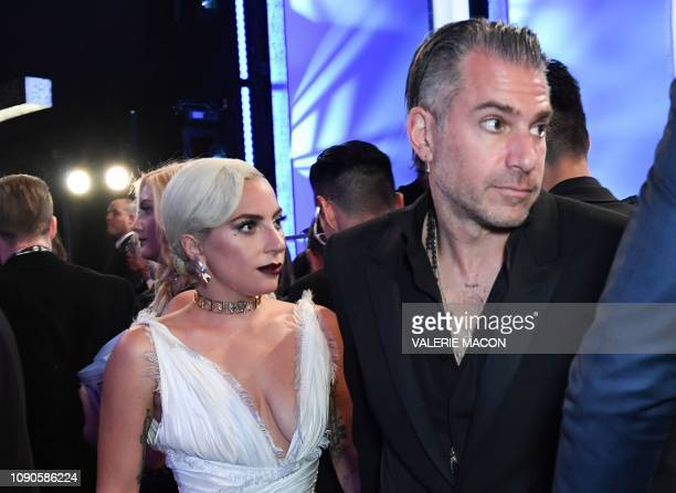 Actress Lady Gaga and fiance Christian Carino attend the 25th Annual Screen Actors Guild Awards show at the Shrine Auditorium in Los Angeles on...
