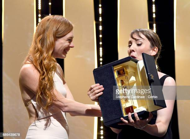 Actress Laetitia Dosch and director Leonor Serraille accept the Camera d'Or for best first film from any section of the entire festival for 'Jeune...