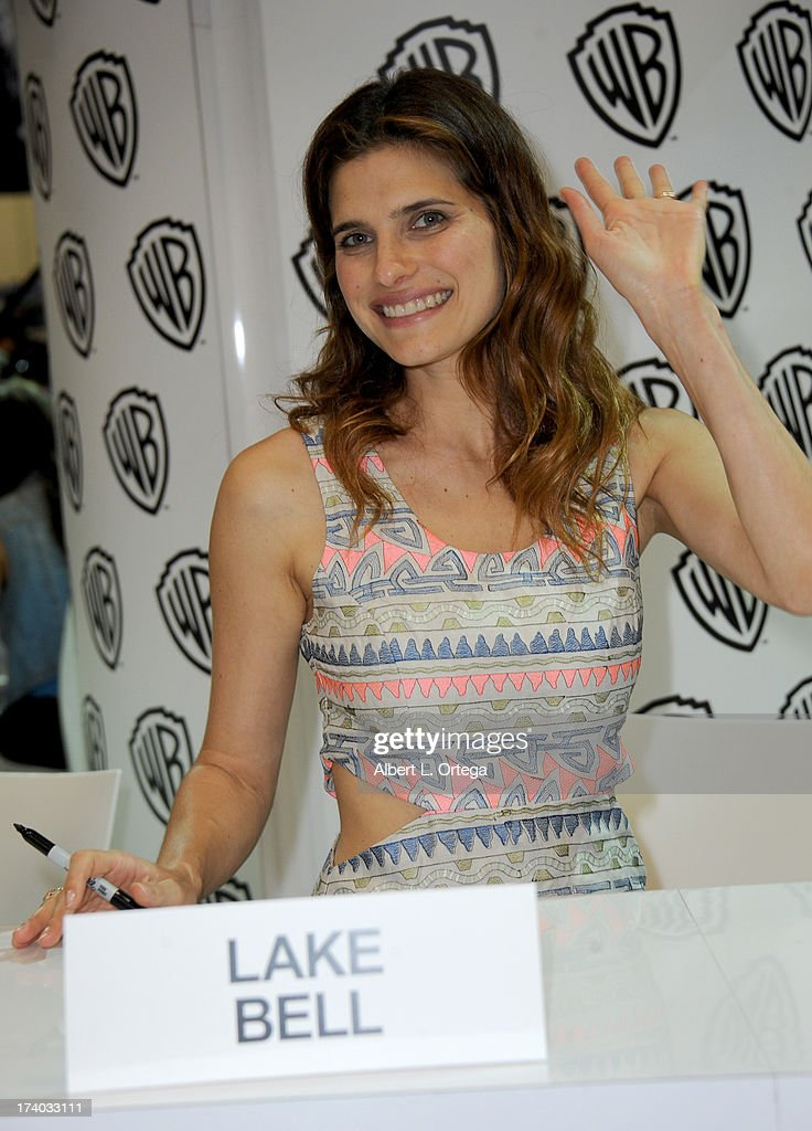 Actress Lake Bell signs autographs during Comic-Con International at San Diego Convention Center on July 19, 2013 in San Diego, California.