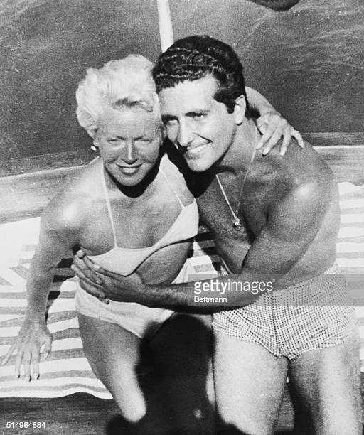 Actress Lana Turner and her gangland boyfriend Johnny Stompanato strike an affectionate pose here taken aboard a pleasure craft in Mexican waters...