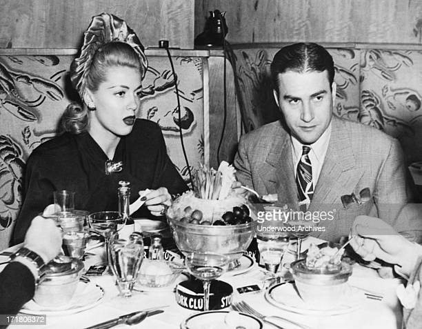 Actress Lana Turner and orchestra leader Artie Shaw having dinner at the Stork Club New York New York November 14 1941 They are together for the...