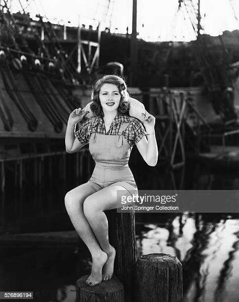 Actress Lana Turner poses for the camera down by the waterfront set at the Warner Brothers studio Her latest film is The Great Garrick a Mervyn LeRoy...