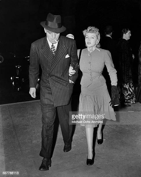 Actress Lana Turner walks with husband actor Greg Bautzer in Los Angeles California