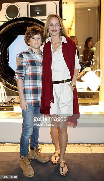 Actress Lara Joy Koerner and her son David attend the reopening of the Tod's store on March 24 2010 in Munich Germany