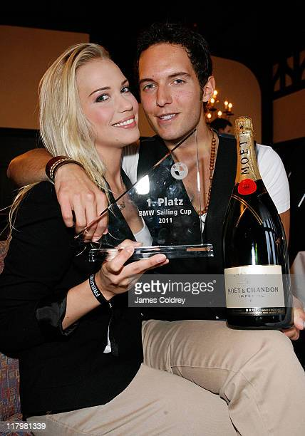 Actress LaraIsabelle Rentinck and boyfriend Marc Philipp attend the 'BMW Sailing Cup' at Lake Wannsee on July 2 2011 in Berlin Germany