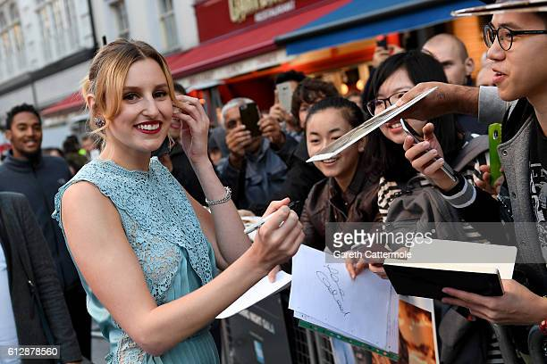 Actress Laura Carmichael signs autographs as she attends the 'A United Kingdom' Opening Night Gala screening during the 60th BFI London Film Festival...
