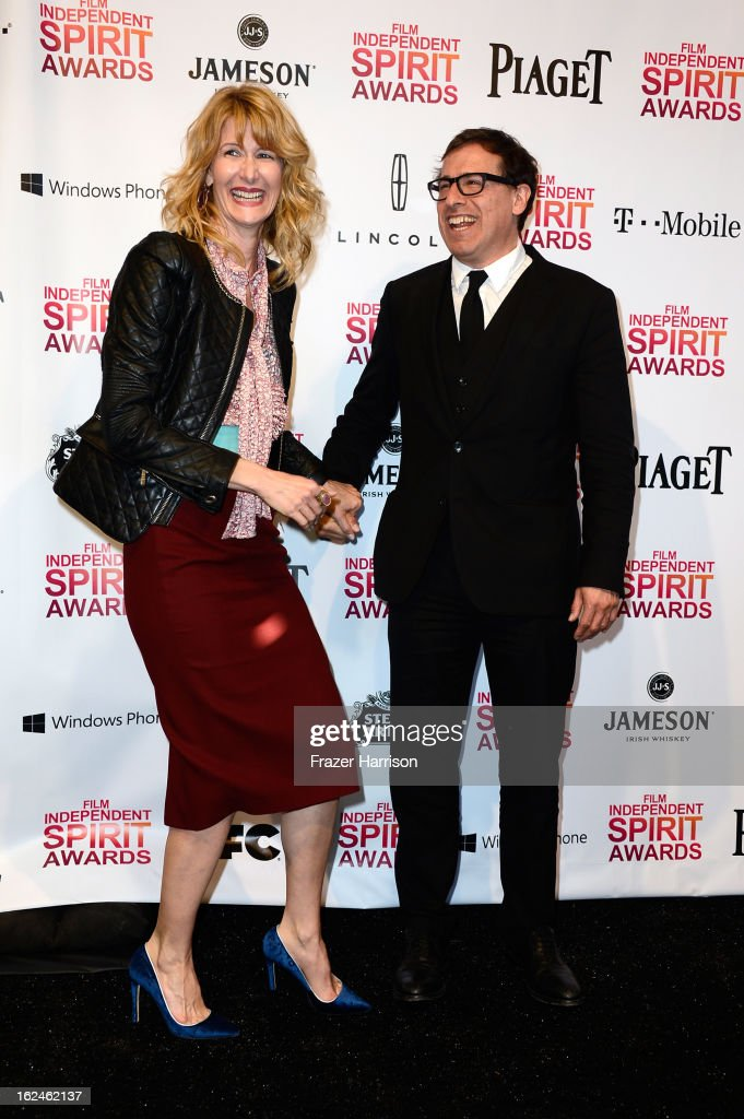 Actress Laura Dern and director David O. Russell pose in the press room during the 2013 Film Independent Spirit Awards at Santa Monica Beach on February 23, 2013 in Santa Monica, California.
