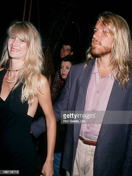 Actress Laura Dern and director Renny Harlin attending the premiere of 'Young Guns 2' on July 30 1990 at Mann Chinese Theater in Hollywood California