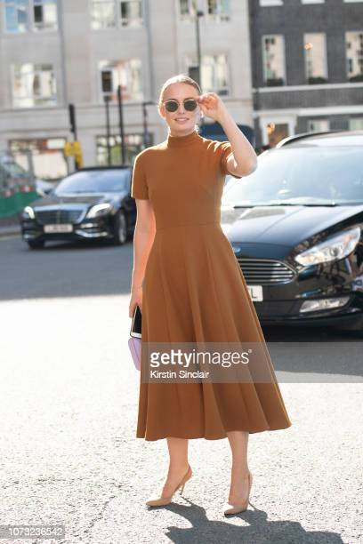 Actress Laura Haddock wears an Emilia Wickstead dress, during London Fashion Week September 2018 on September 17, 2018 in London, England.