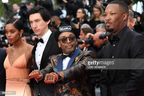 US actress Laura Harrier US actor Adam Driver US director Spike Lee and US actor Corey Hawkins pose as they arrive on May 14 2018 for the screening...