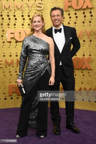 US actress Laura Linney and husband Marc Schauer arrive for the 71st Emmy Awards at the Microsoft Theatre in Los Angeles on September 22 2019