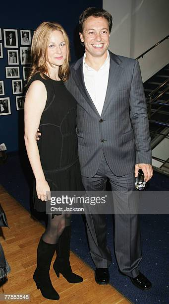 Actress Laura Linney and Marc Schauer arrives at the premiere of Savages at Odeon Leicester Square during the BFI 51st London Film Festival on...