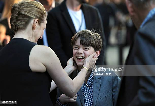 Actress Laura Linney greets actor Milo Parker as they attend the UK Premiere of Mr Holmes at the Odeon Kensington on June 10 2015 in London England