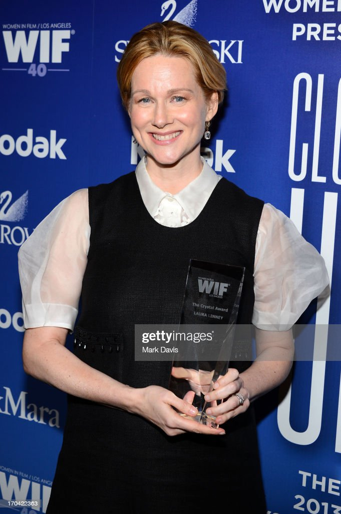 Actress Laura Linney poses with the Crystal Award for Excellence in Film backstage at Women In Film's 2013 Crystal + Lucy Awards at The Beverly Hilton Hotel on June 12, 2013 in Beverly Hills, California.