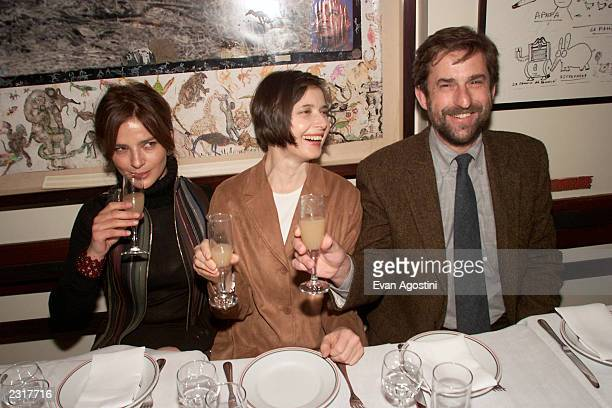Actress Laura Morante dinner host Isabella Rossellini and director Nanni Moretti share a toast at the screening afterparty for The Son's Room at...