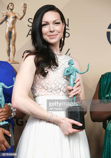 Actress Laura Prepon cowinner of Outstanding Performance by an Ensemble in a Comedy Series for 'Orange Is the New Black' poses in the press room...