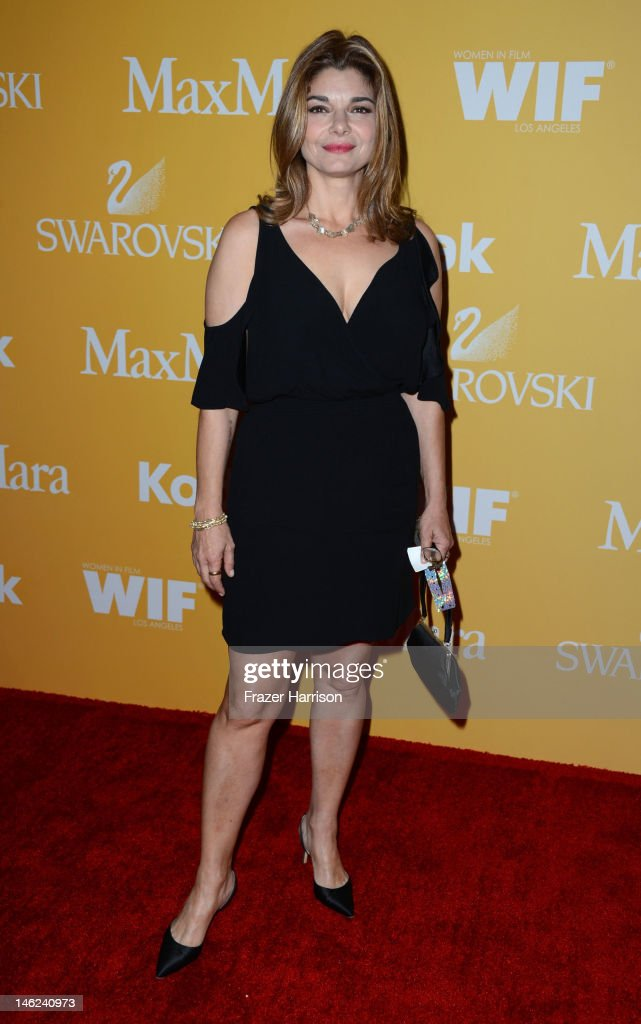 Actress Laura San Giacomo arrives at the 2012 Women In Film Crystal + Lucy Awards at The Beverly Hilton Hotel on June 12, 2012 in Beverly Hills, California.
