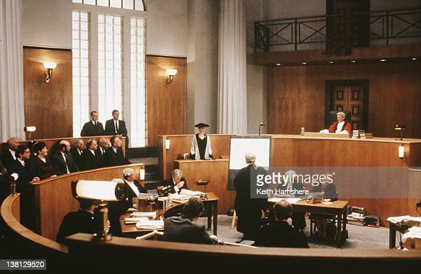 Actress Laura San Giacomo stands up in court in a scene from the thriller 'Under Suspicion' 1991
