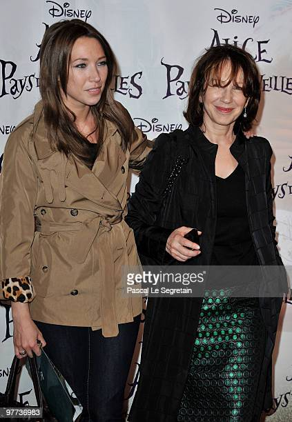 Actress Laura Smet arrives with mother Nathalie Baye to attend the premiere of Tim Burton's film 'Alice au pays des merveilles' at Theatre Mogador on...