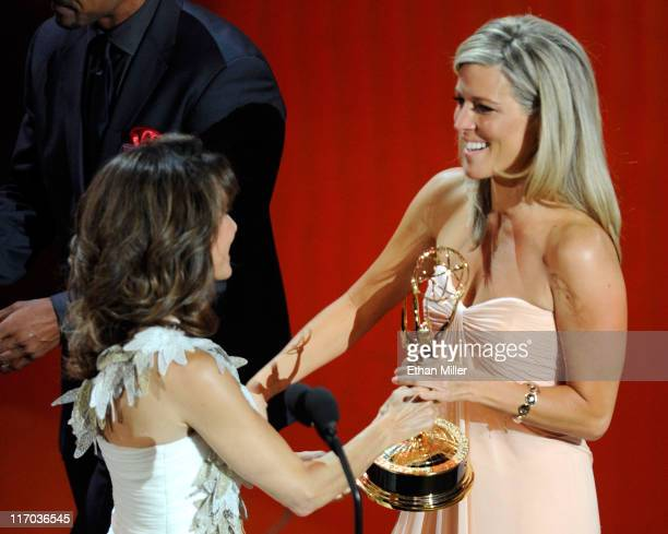 Actress Laura Wright accepts the Outstanding Lead Actress award from Susan Lucci onstage during the 38th Annual Daytime Entertainment Emmy Awards...