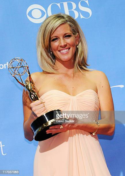 Actress Laura Wright poses with the Outstanding Lead Actress award in the press room at the 38th Annual Daytime Entertainment Emmy Awards held at the...