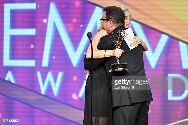 Actress Laura Wright presents Emmy award for Outstanding Lead Actor in a Drama to Actor Tyler Christopher onstage at the 43rd Annual Daytime Emmy...