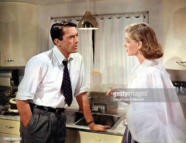 "Actress Lauren Bacal and Gregory Peck in a scene from the movie""Designing Woman"""
