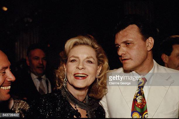 Actress Lauren Bacall and French fashion designer Jean-Charles de Castelbajac on the set of the film Prêt-à-Porter, , directed by American director...