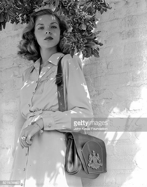 Actress Lauren Bacall for Warner Bros Studios posing for photographs outdoors 1945