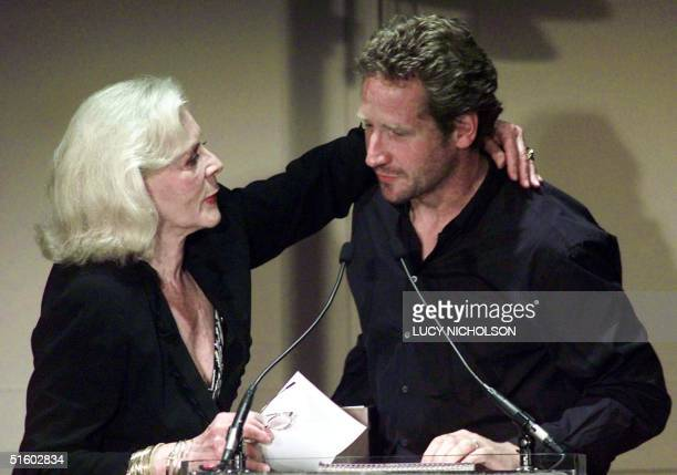 US actress Lauren Bacall hugs her son Sam Robards after he presented her with the Julie Harris Lifetime Achievement Award at the 2001 Los Angeles...