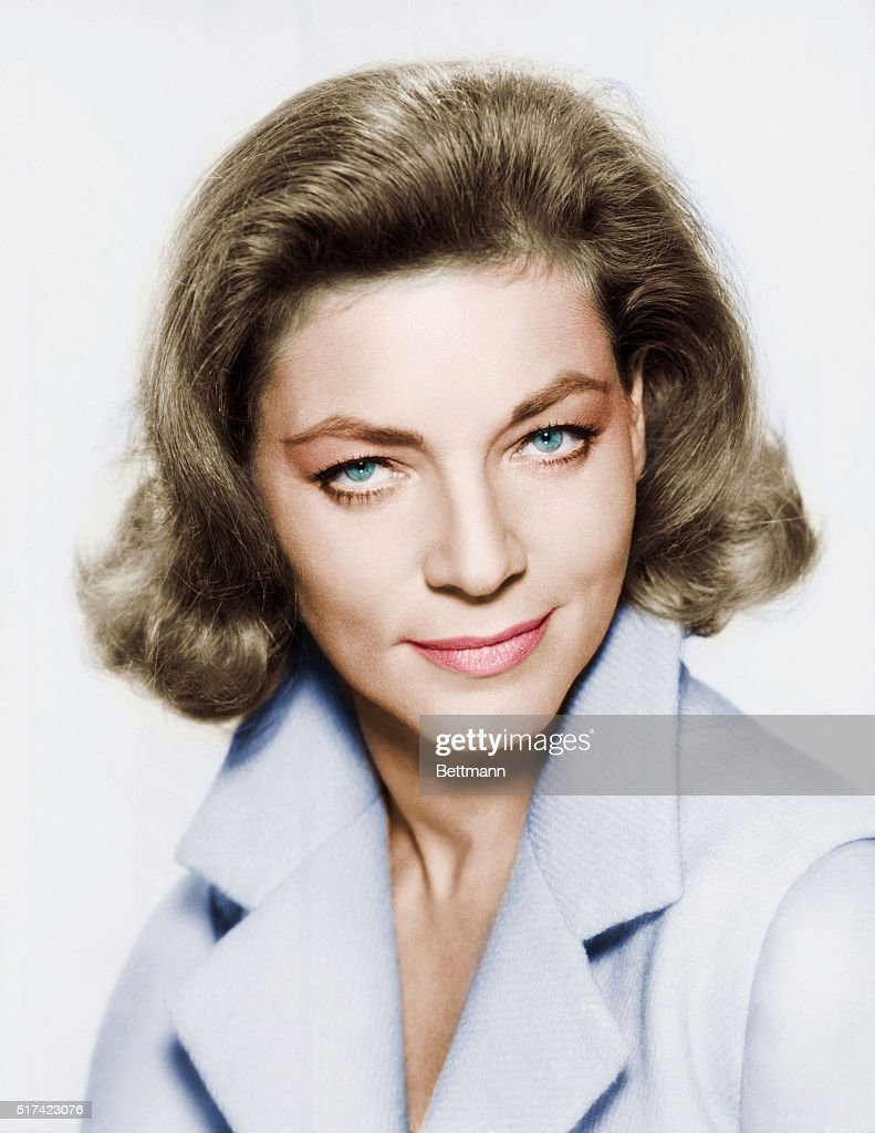 Actress Lauren Bacall with her chin down and her eyes looking up. ca. 1960