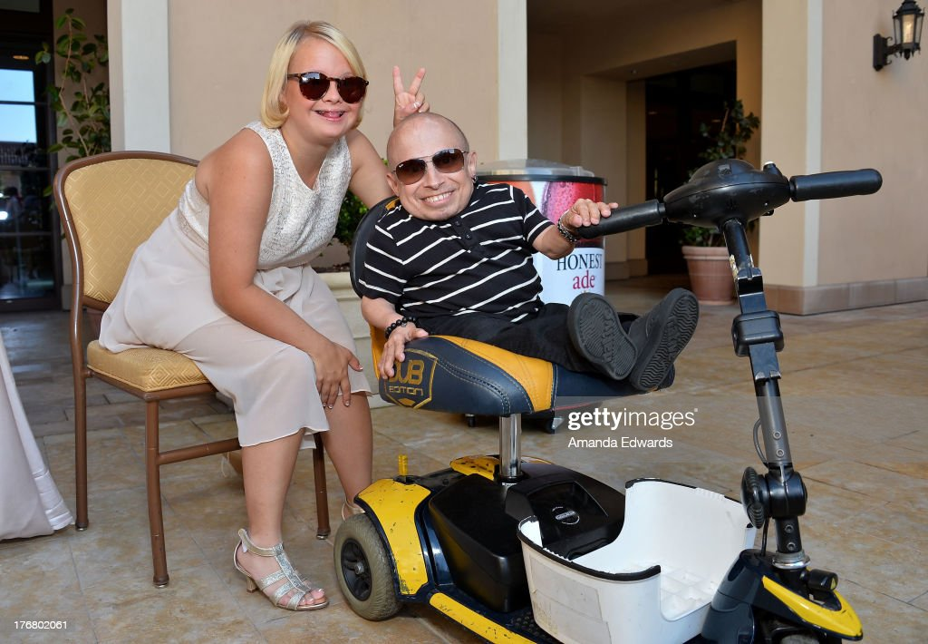 Actress Lauren Potter (L) and actor Verne Troyer attend the Team Maria benefit for Best Buddies at Montage Beverly Hills on August 18, 2013 in Beverly Hills, California.