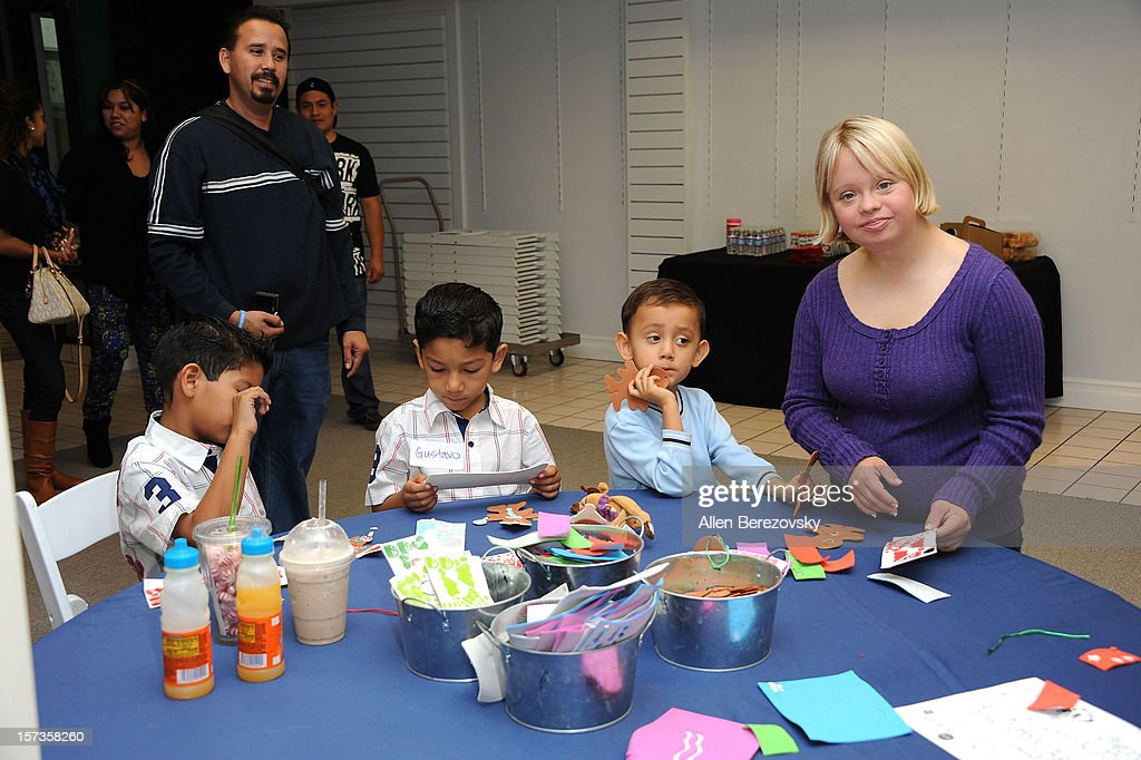 Actress Lauren Potter (R) does arts and crafts with kids at the Westminster Mall's Caring Santa event on December 2, 2012 in Westminster, California.