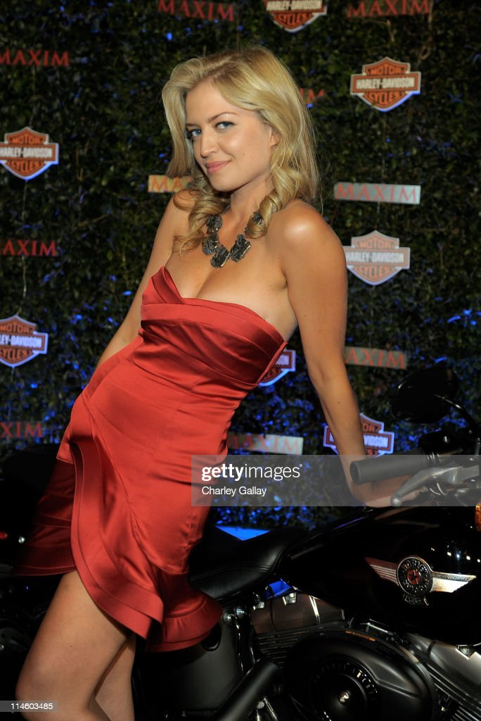 Actress Lauren Storm turns the key on a Harley-Davidson to raise money for Harley's Heroes at the 2010 Maxim Hot 100 Party held at Paramount Studios on May 19, 2010 in Los Angeles, California.