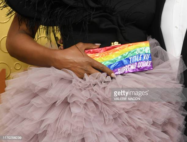 TOPSHOT US actress Laverne Cox holds a purse as she arrive for the 71st Emmy Awards at the Microsoft Theatre in Los Angeles on September 22 2019