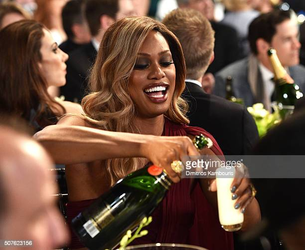 Actress Laverne Cox pours a glass of champagne during The 22nd Annual Screen Actors Guild Awards at The Shrine Auditorium on January 30, 2016 in Los...