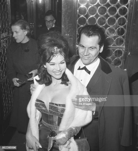 Actress Laya Raki with husband Ron Randell attend the world premiere of Zulu which was held at the Plaza Theatre in London The premiere was in aid of...